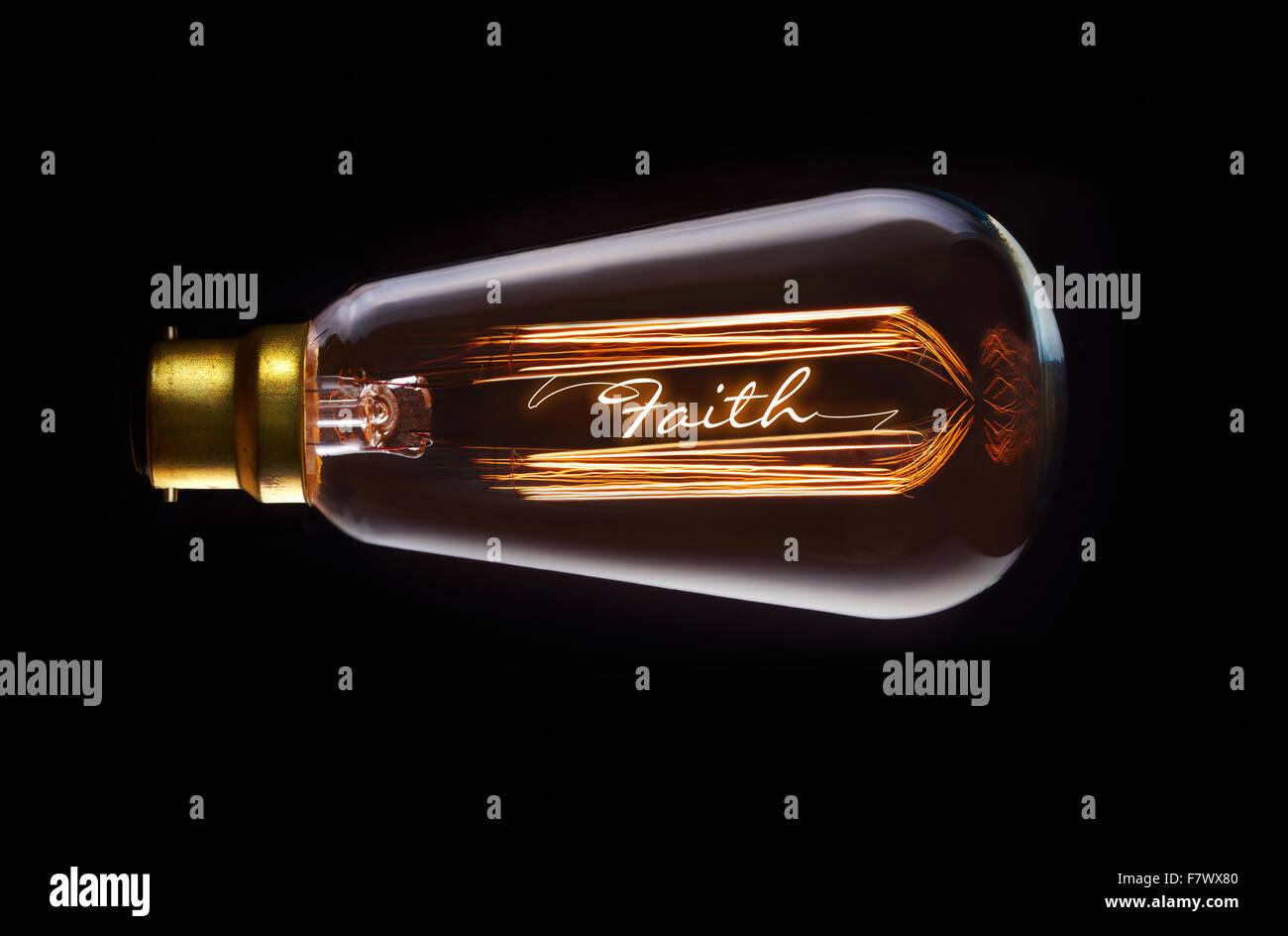 Religion, Faith concept in a filament lightbulb. - Stock Image