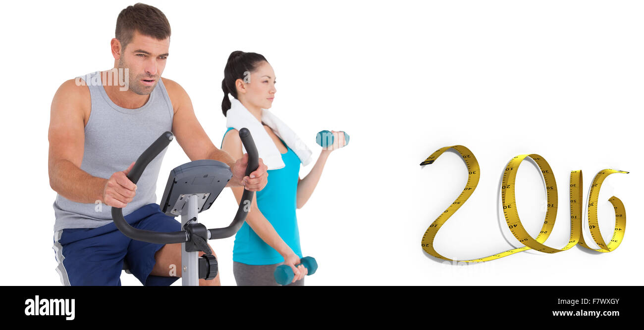 Composite image of man and woman working out - Stock Image