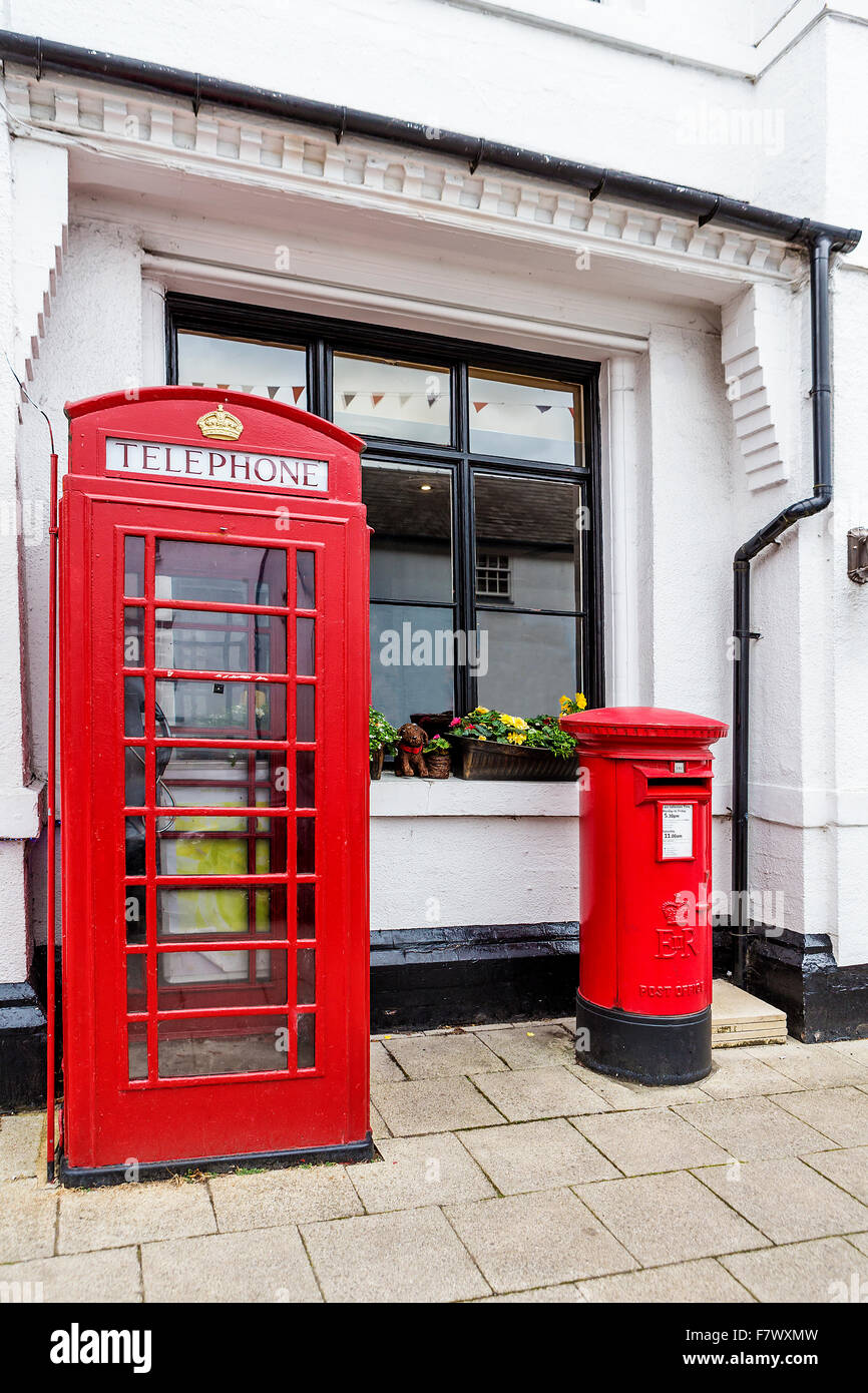 Telephone kiosk and pillar box outside a white building in King Street, Knutsford, Cheshire, England, UK - Stock Image