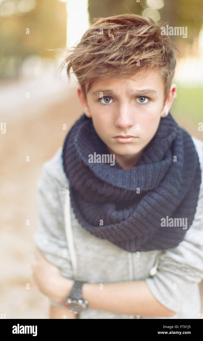 Portrait of a boy looking worried - Stock Image