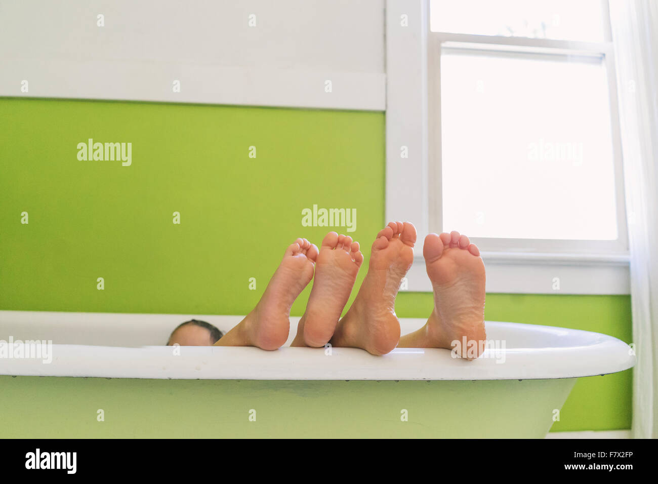 Feet of two children in the bath - Stock Image