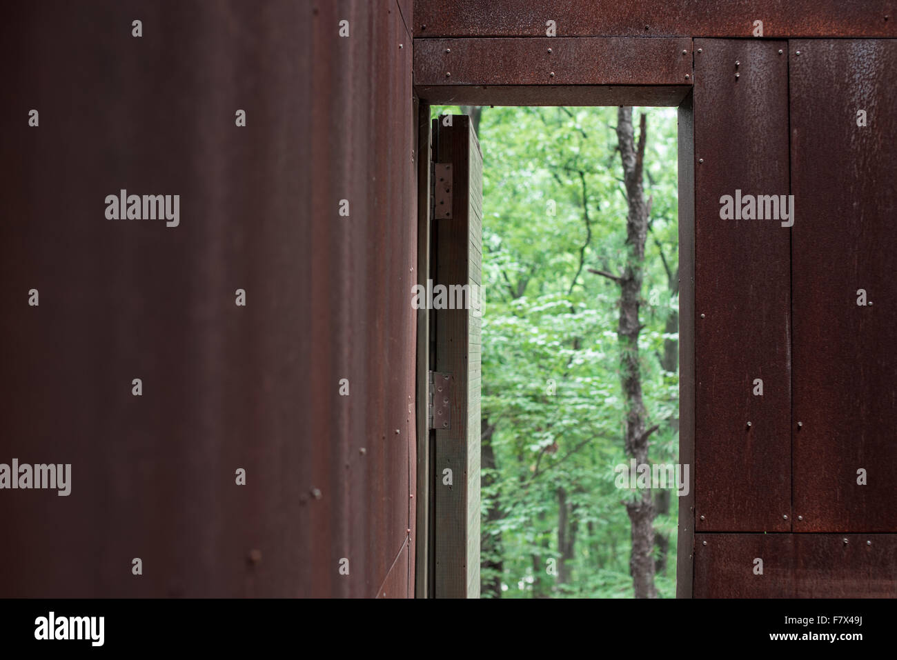 Door Opening into forest, Anyang, Gyeonggi-do, South Korea - Stock Image