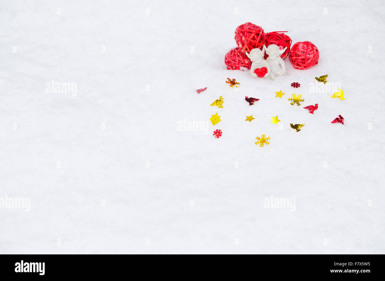 angels with heart on snow - Stock Image