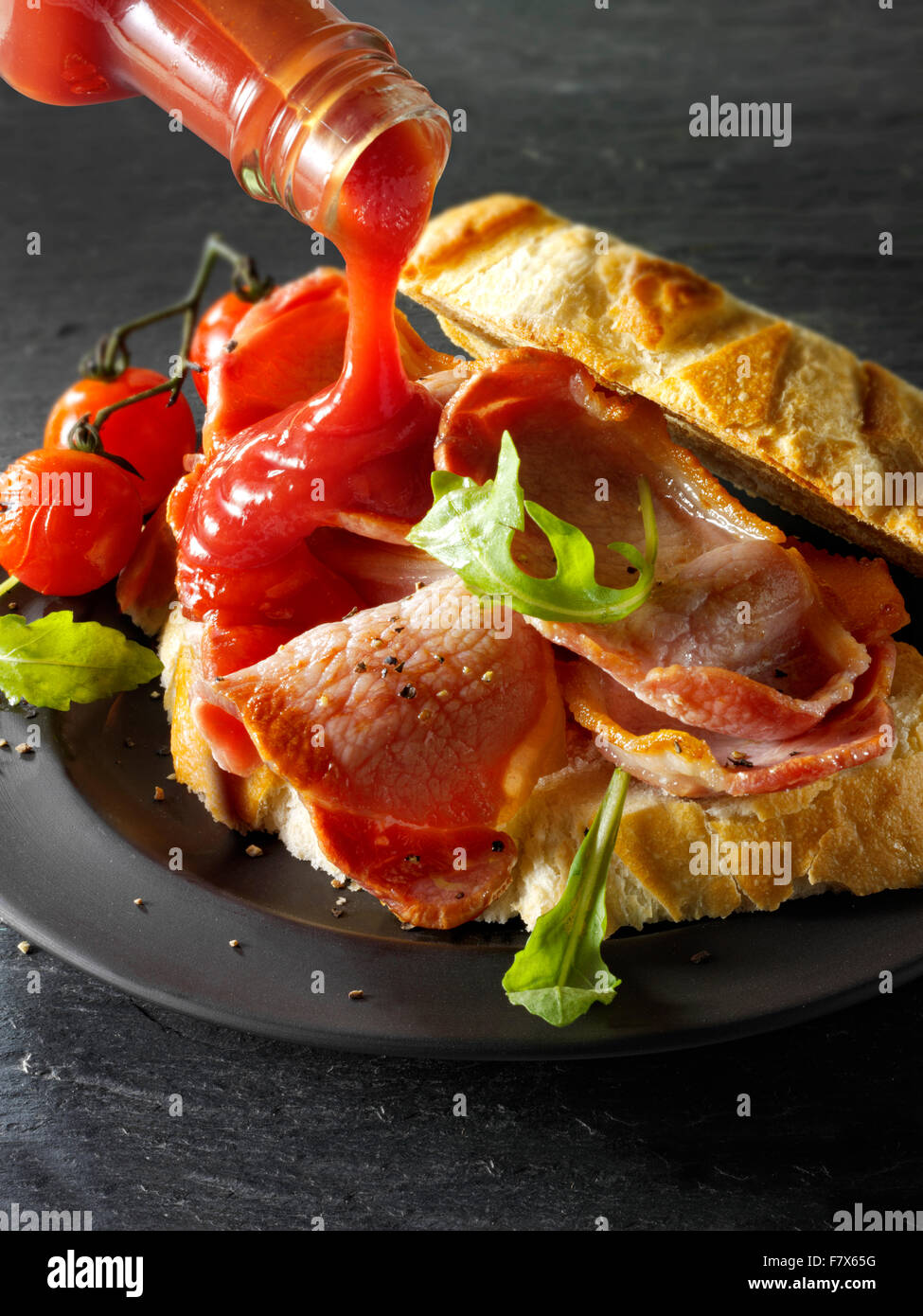 Prepared bacon sandwich  with tomato ketchup sandwich - Stock Image