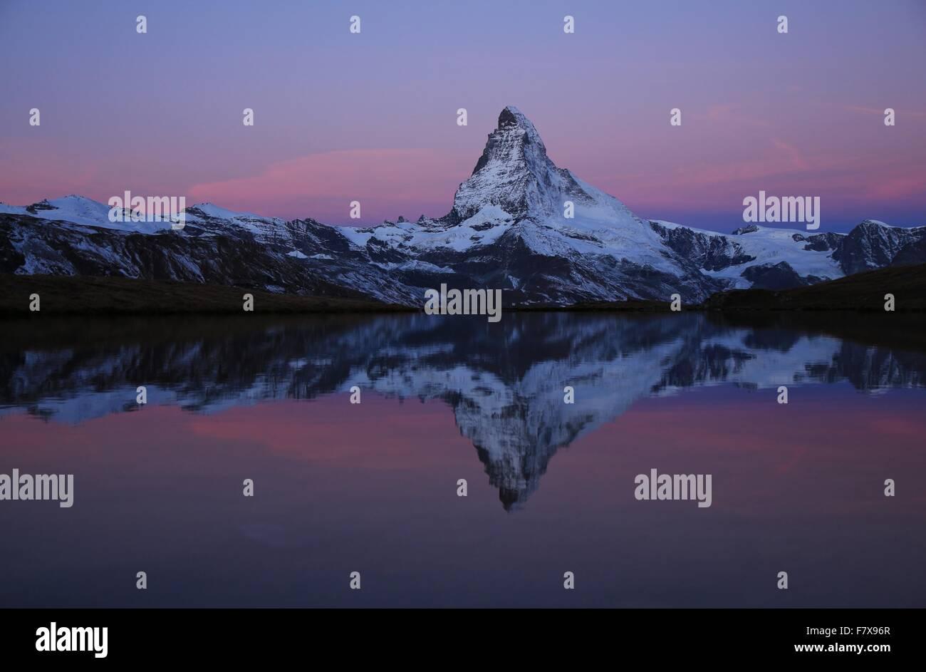 Pink morning sky over the Matterhorn - Stock Image