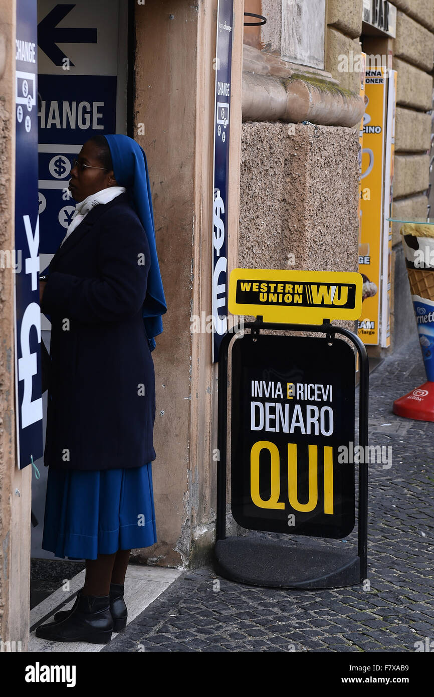 Rome, Italy. 3rd Dec, 2015.  A nun in the queue in a currency exchange in a street neighboring San Pietro square. - Stock Image