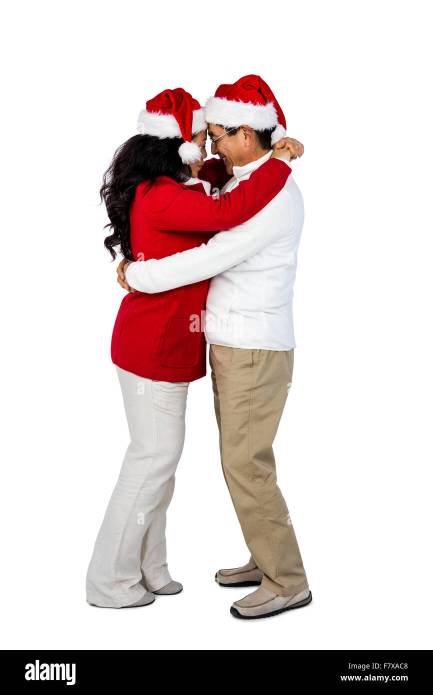 Festive senior couple hugging - Stock Image