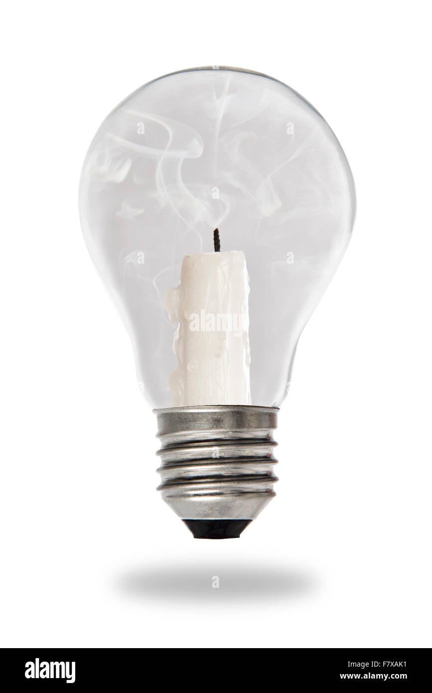 Unlit candle smoldering inside a tungsten bulb type - Stock Image