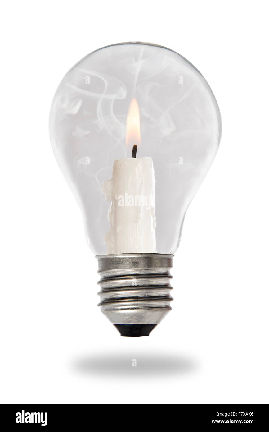 Candle lit steaming inside a tungsten bulb type - Stock Image