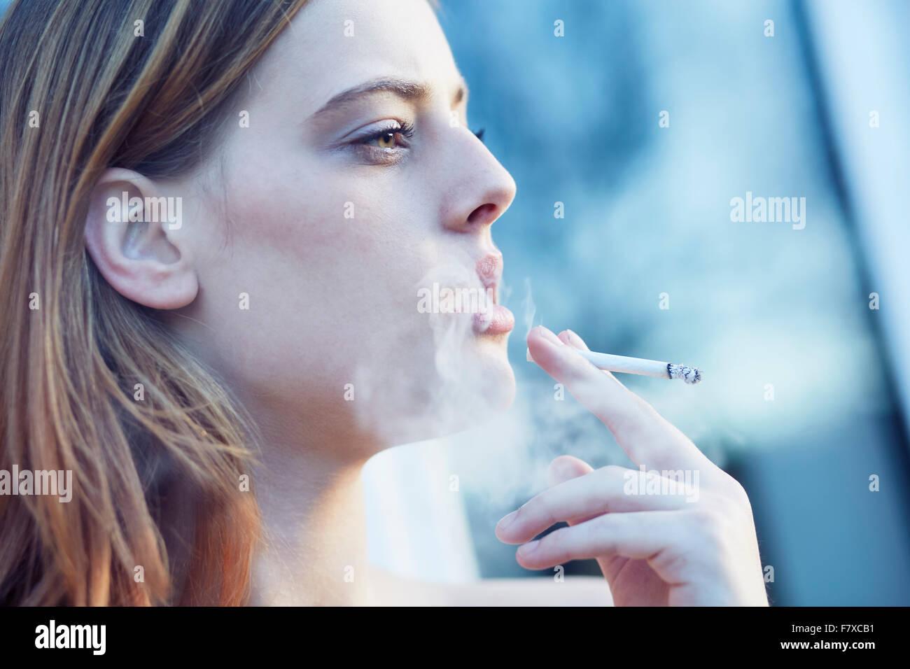 Woman smoking - Stock Image