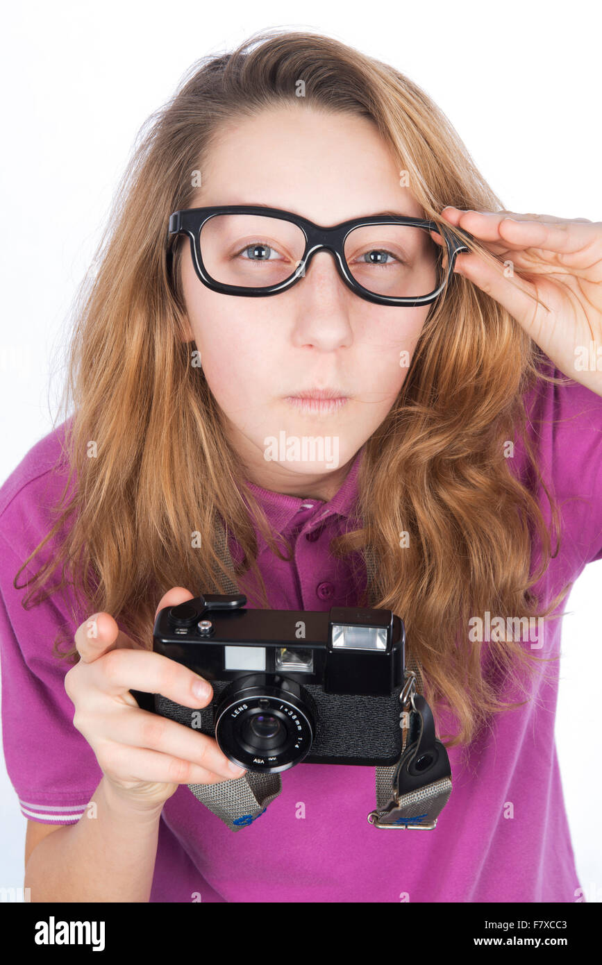 Young photographer presumptuous, look holding glasses - Stock Image