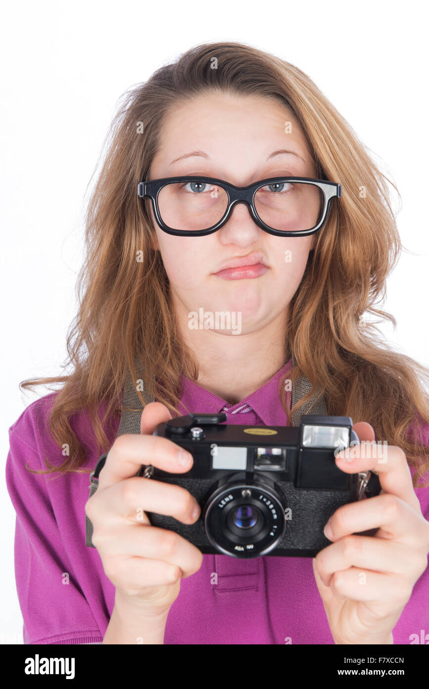 Young nerd photographer with camera in hand - Stock Image