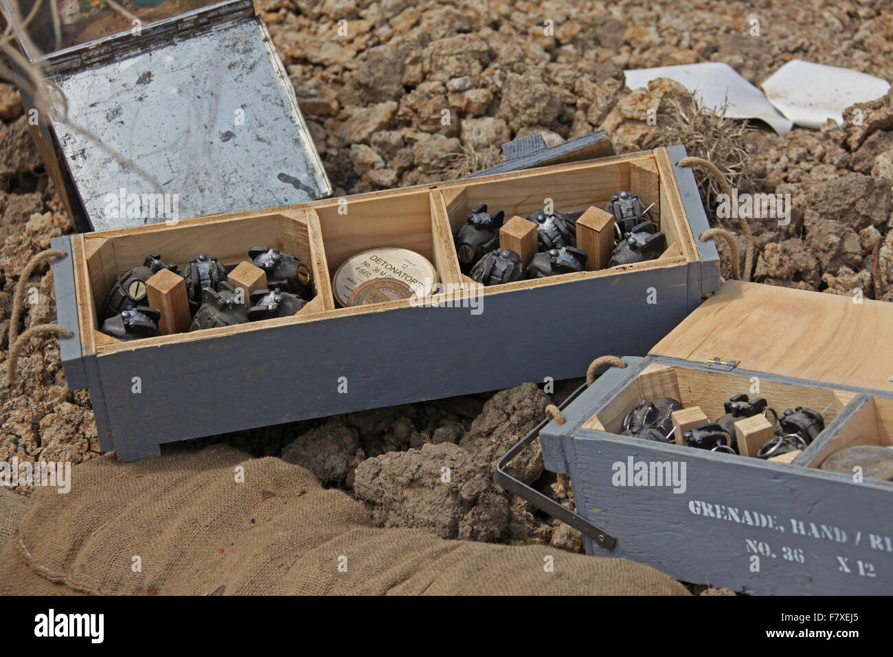 A re-enactors box of 36 Mills grenades on display in a trench like setting during a military display. - Stock Image