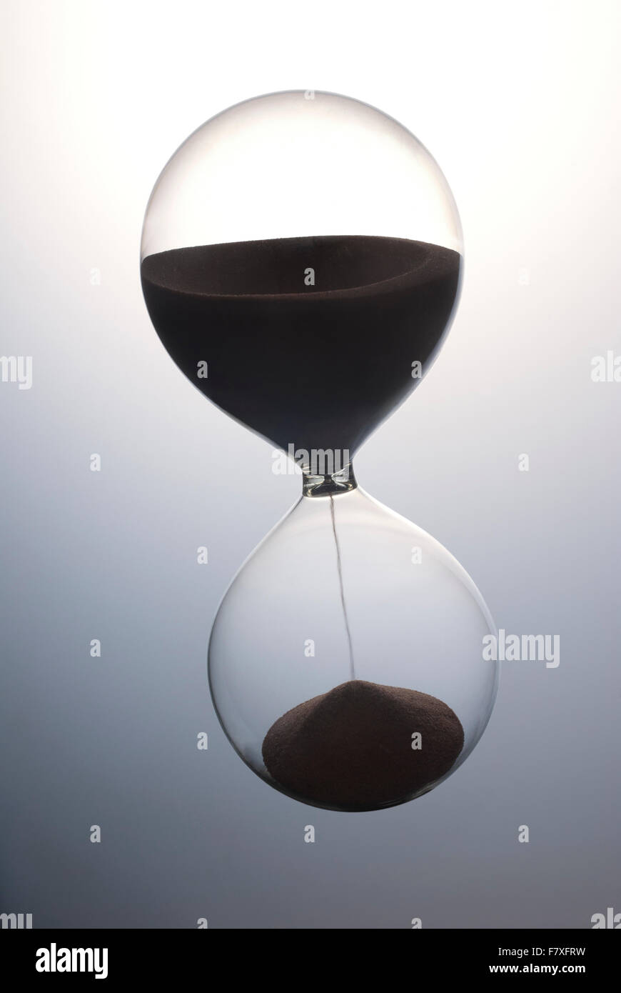 An hour-glass timer full of sand - Stock Image