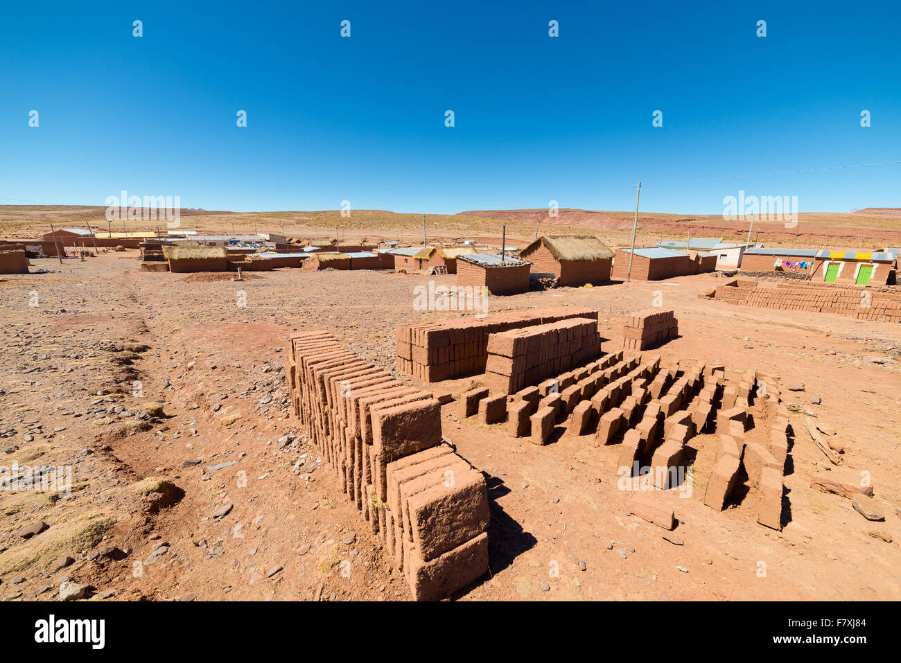 Rural village in the desertic landscape on the Andean Highlands, in Bolivia. Mud bricks, known as 'Adobe', - Stock Image