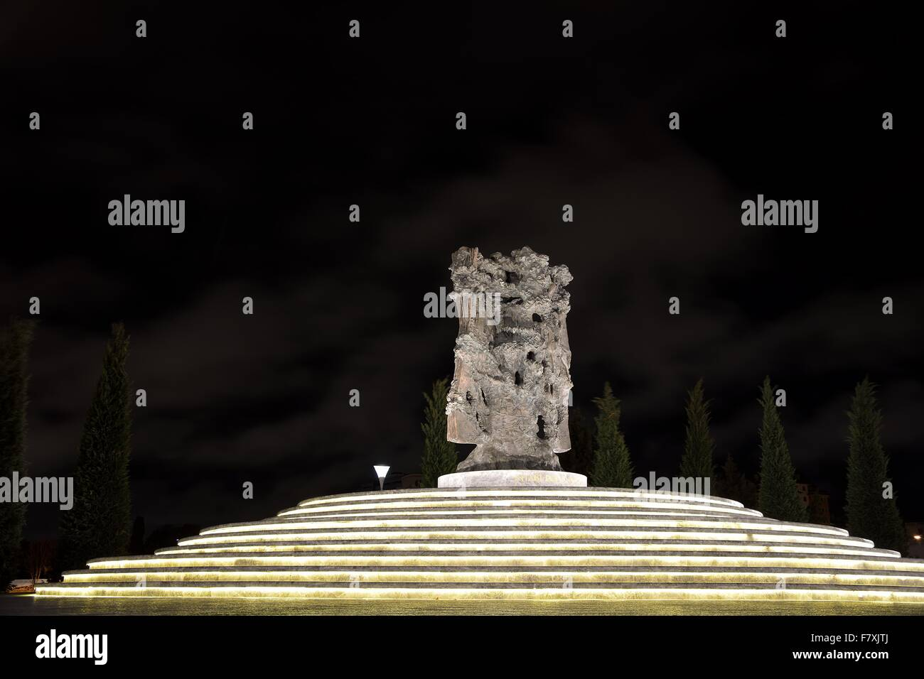 Sculpture at night in Dede Gorgud Park, Baku, capital of Azerbaijan - Stock Image