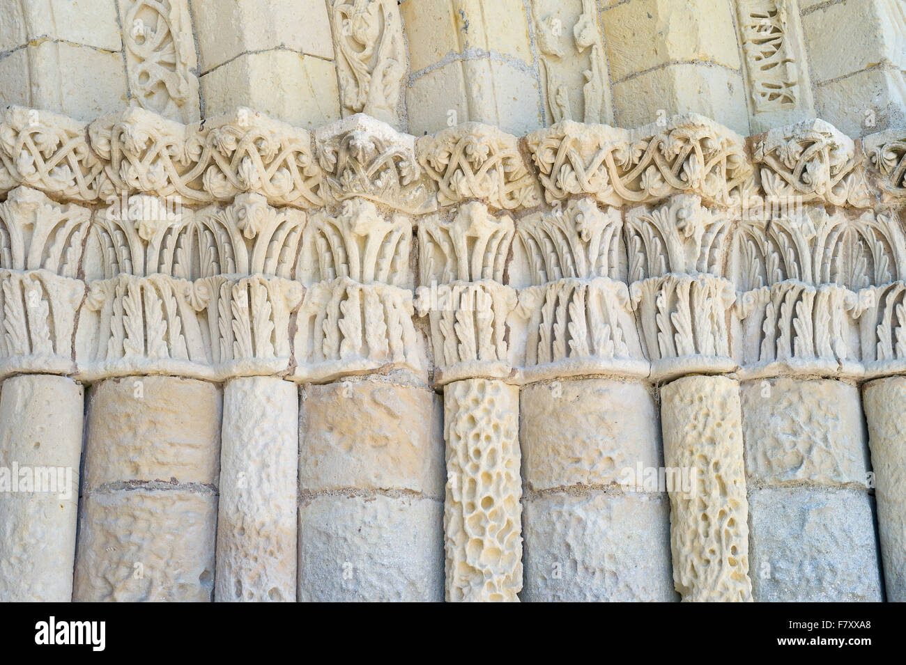 Decorative stone carving above the entrance door to St Peter's Church – Eglise Saint-Pierre, Echebrune, Charente - Stock Image