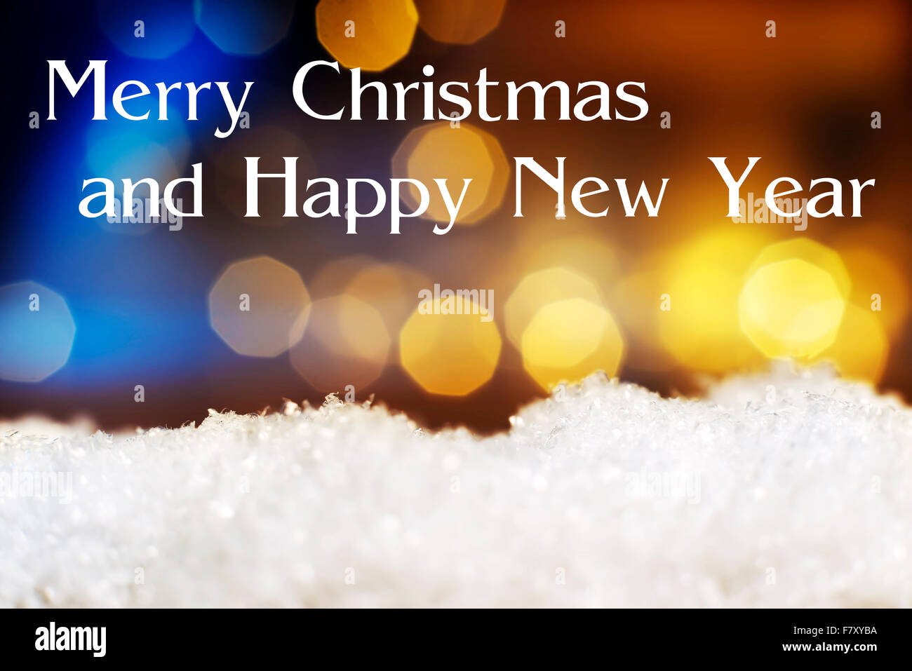 Image of artificial snow and bokeh lights in background and text Merry Christmas and Happy New Year - Stock Image