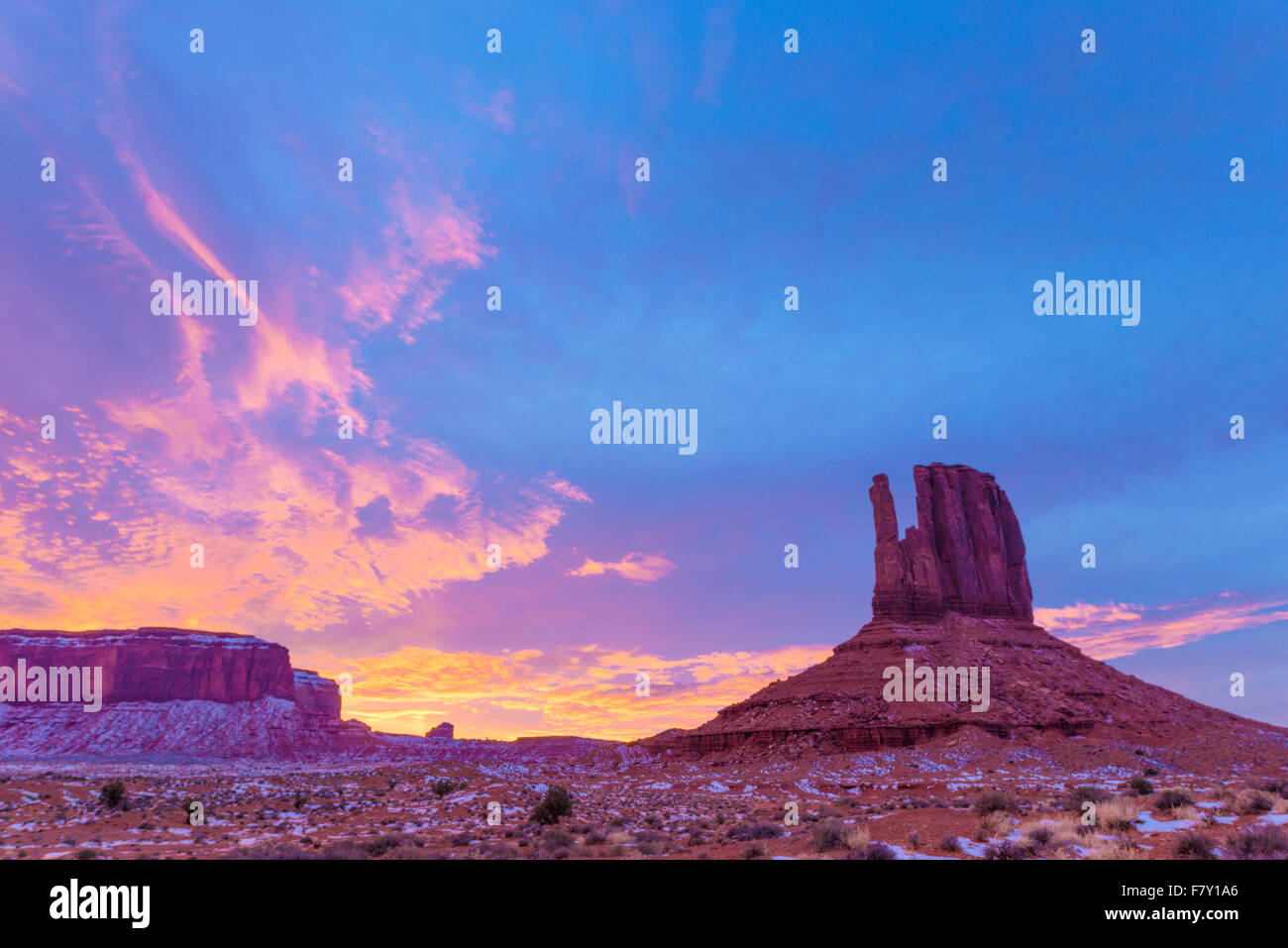 West Mitten Butte and sunset, Monument Valley Tribal Park, Arizona Navajo Reservation - Stock Image