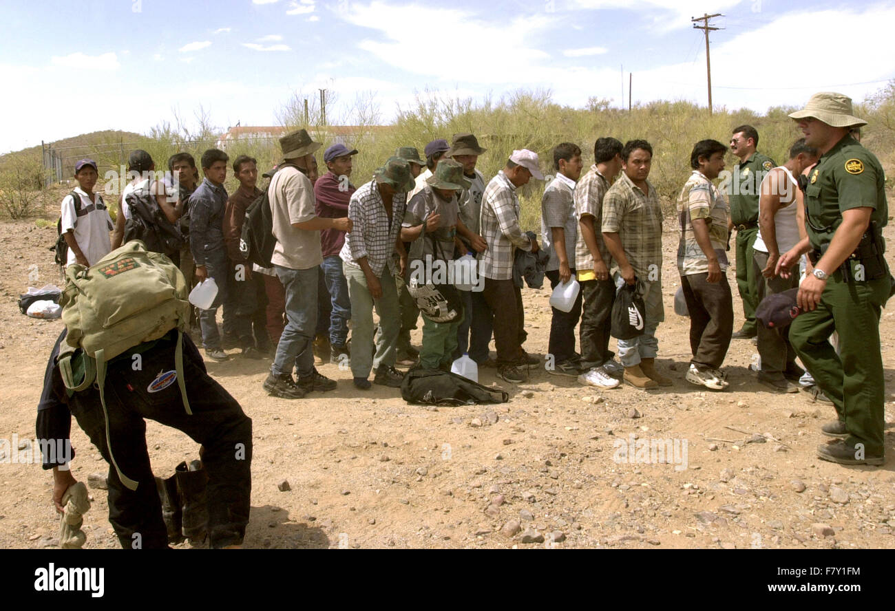 Officials process undocumented migrants, who crossed from Mexico on to the Tohono O'odham Nation in Arizona, - Stock Image