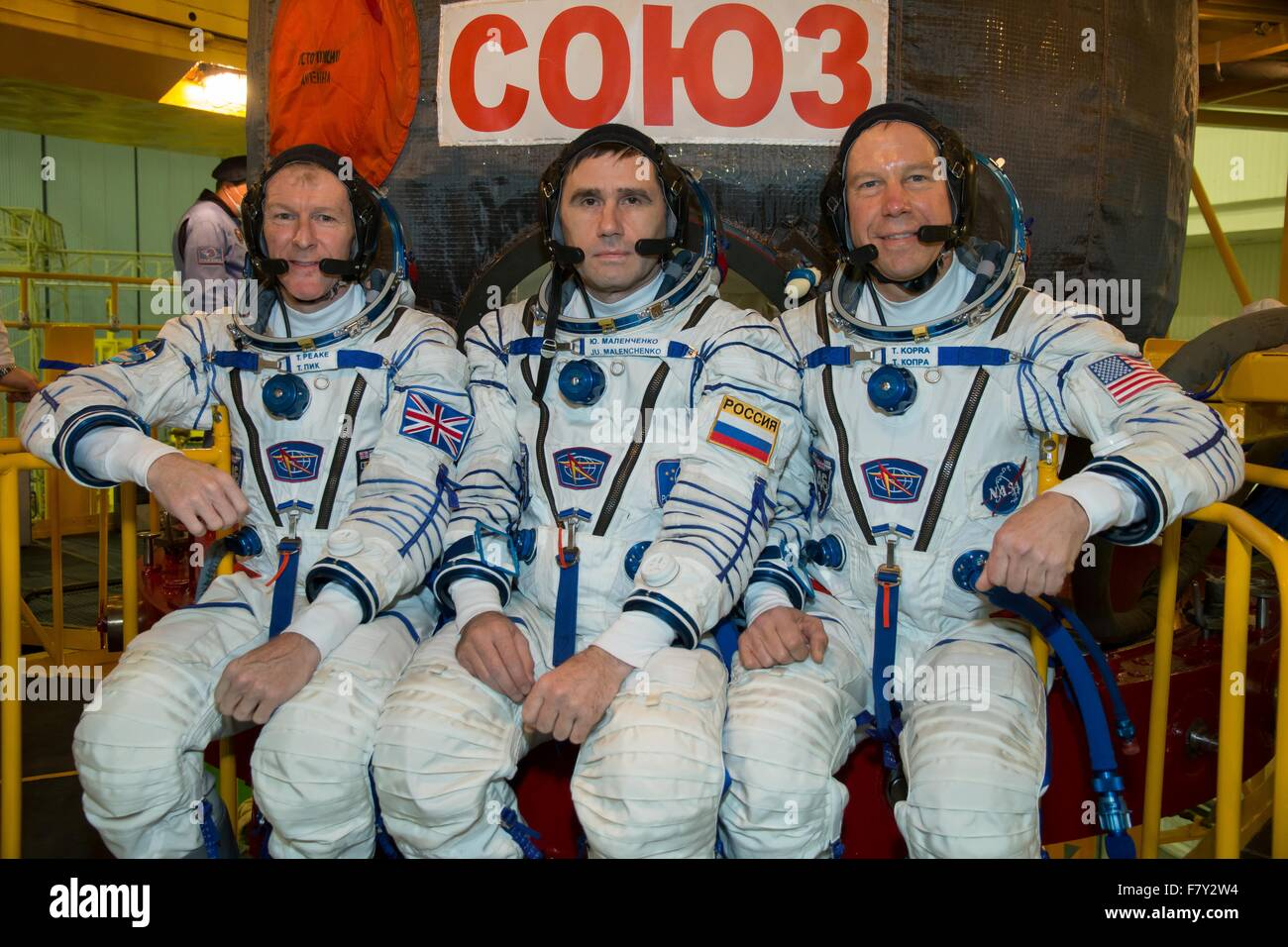International Space Station Expedition 46 crew members pose in front of their Soyuz TMA-19M spacecraft during a - Stock Image