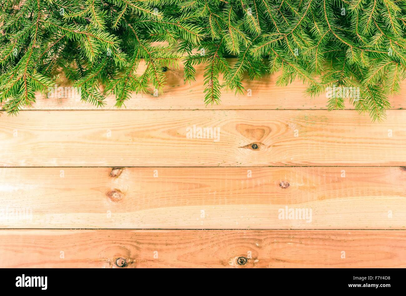 Christmas background. Green branches of christmas trees on wooden ...
