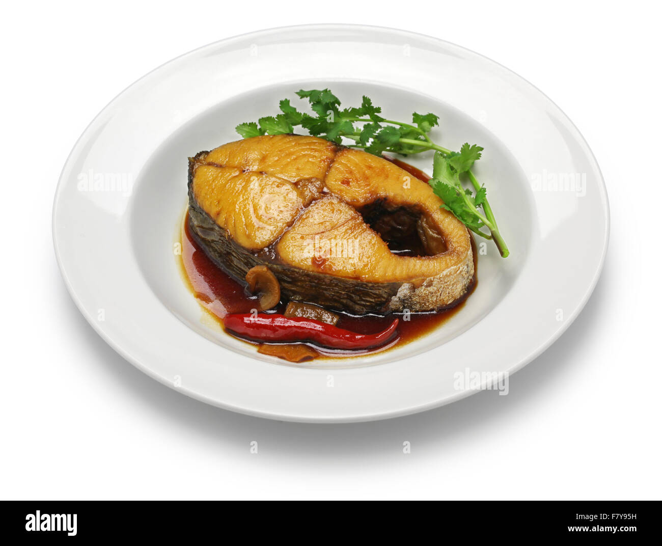 ca thu kho, king mackerel simmered in caramelized sauce, vietnamese cuisine - Stock Image
