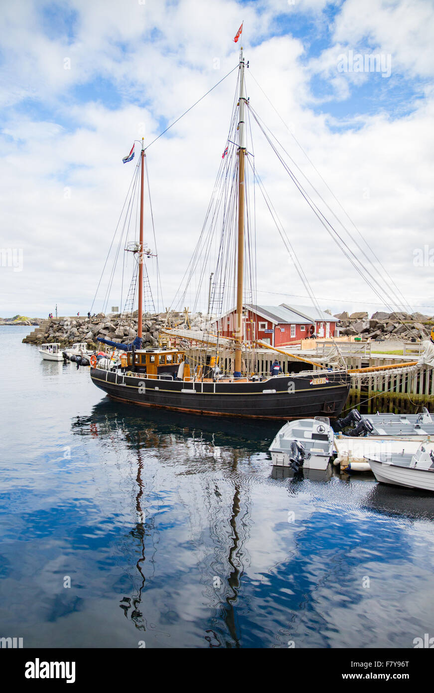 Small two masted ketch sailing vessel moored in the harbour at ' A ' in the Western Lofoten Islands of Norway - Stock Image