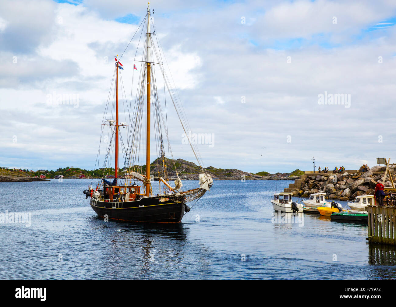 Two masted ketch sailing vessel arriving at ' A ' harbour in the western Lofoten Islands Norway - Stock Image
