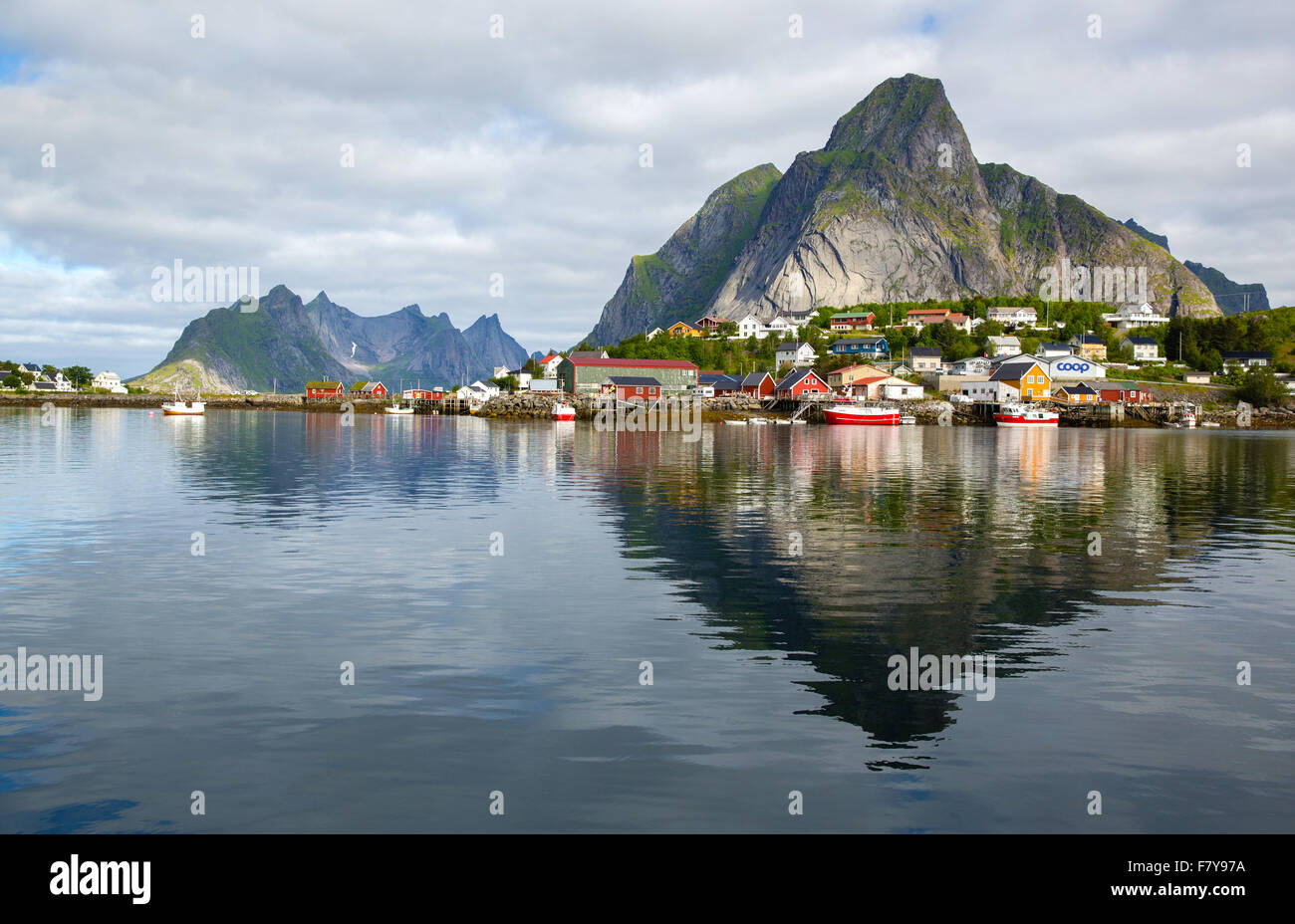 The fishing village of Reine and the peak of Olstinden in the western Lofoten Islands in north Norway Stock Photo
