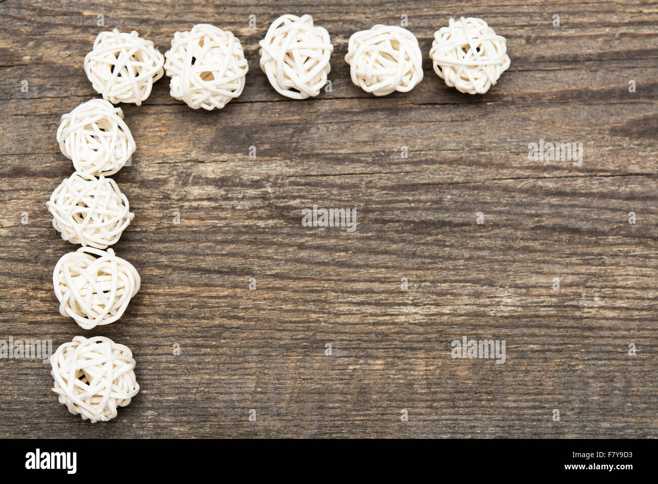 Holiday background with decorative white balls on wooden desk with copy space - Stock Image