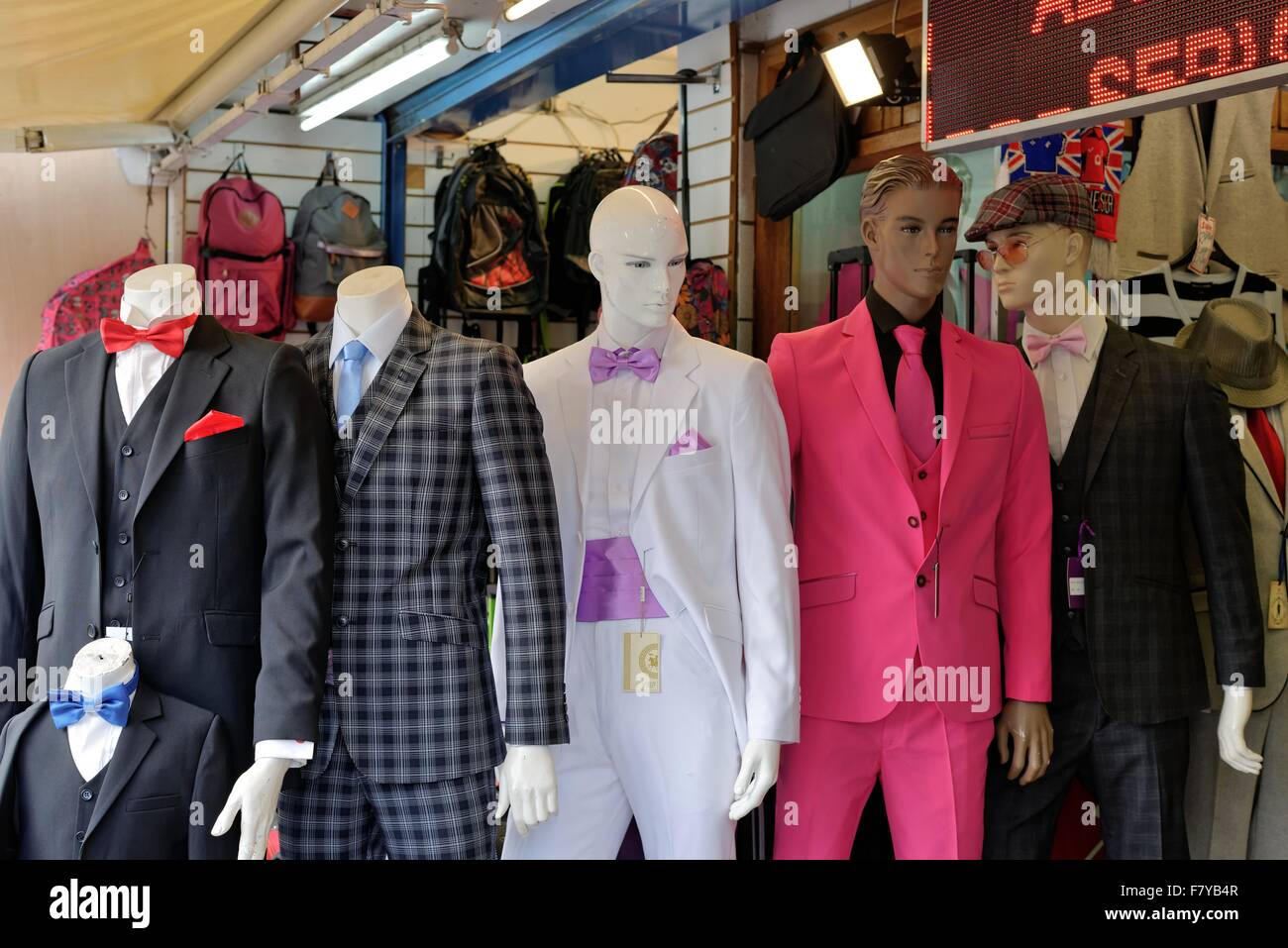 Colouful mens suits on display outside tailors shop Hounslow west London - Stock Image