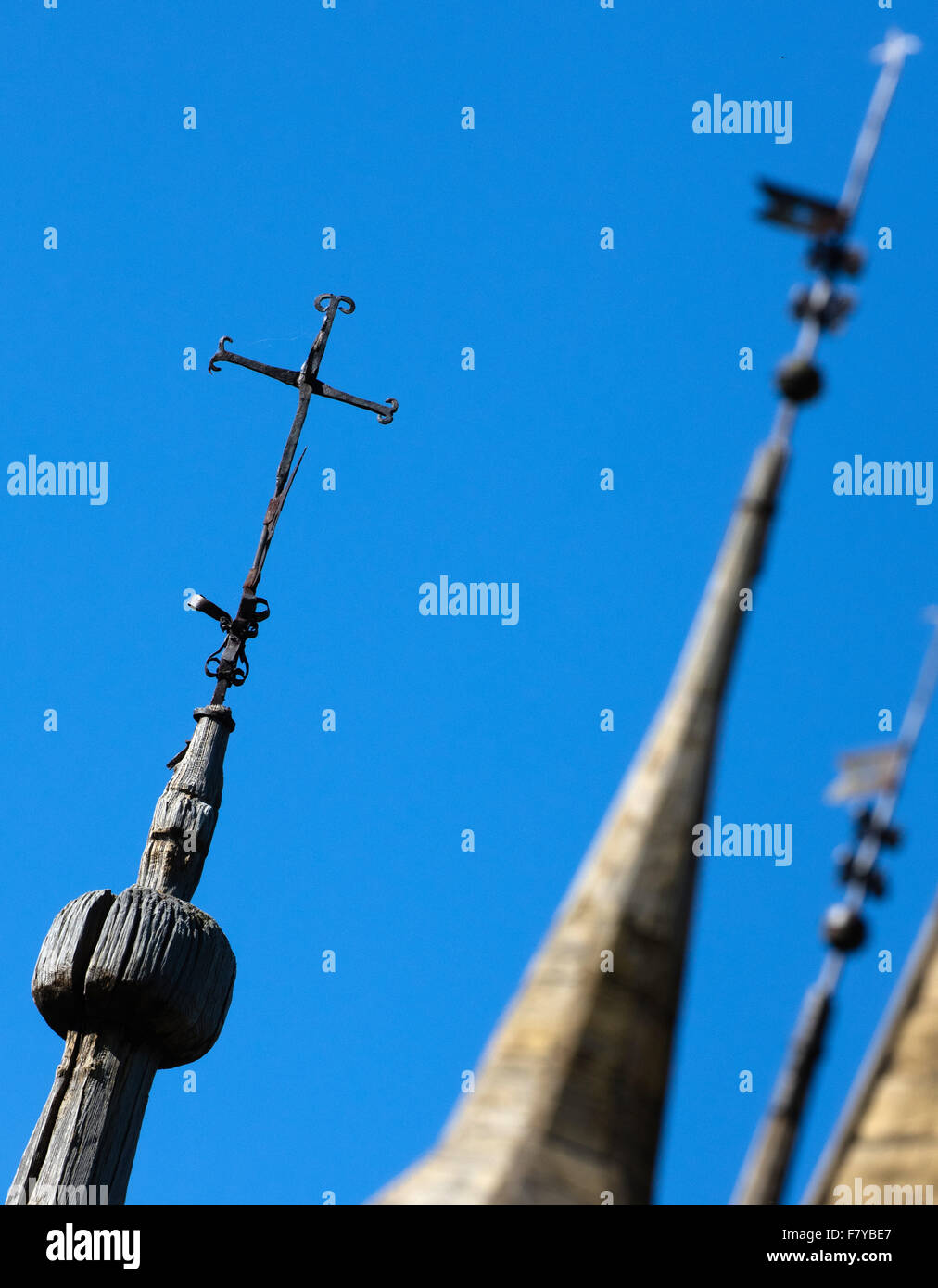 Spire and crosses on the ancient Lom stave church in Oppland central Norway - Stock Image