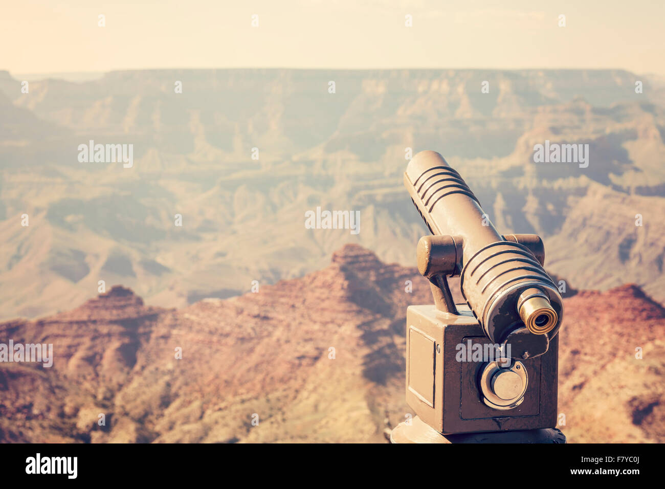 Retro toned telescope pointed at Grand Canyon, travel concept, USA. - Stock Image