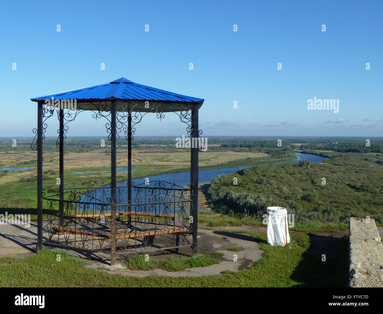 Landscape with summerhouse and river on background blue sky - Stock Image