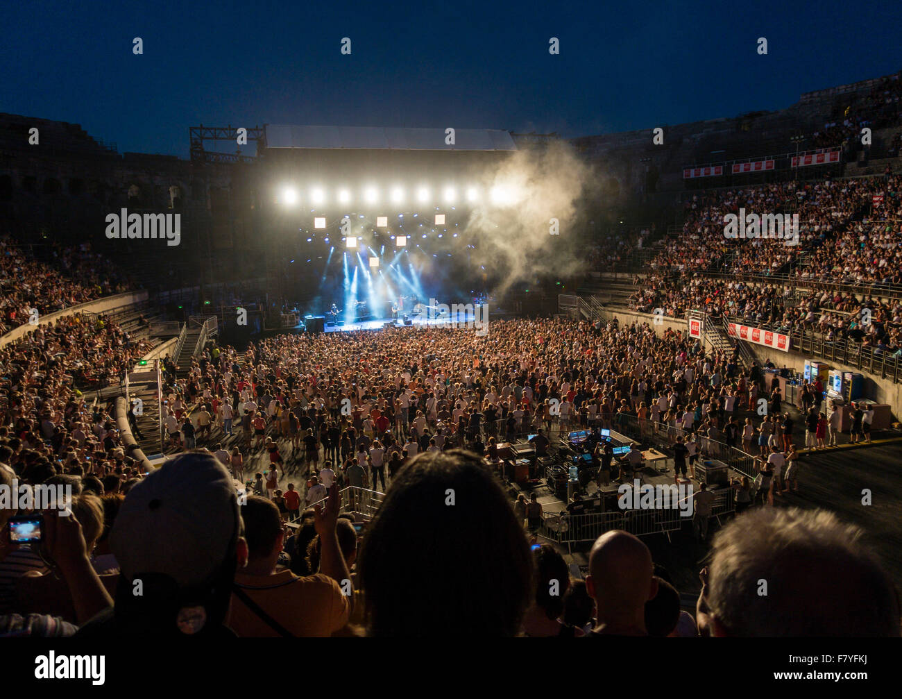 English rock musician and singer-songwriter Sting has a concert in the old historical roman arena at Nimes in southern - Stock Image