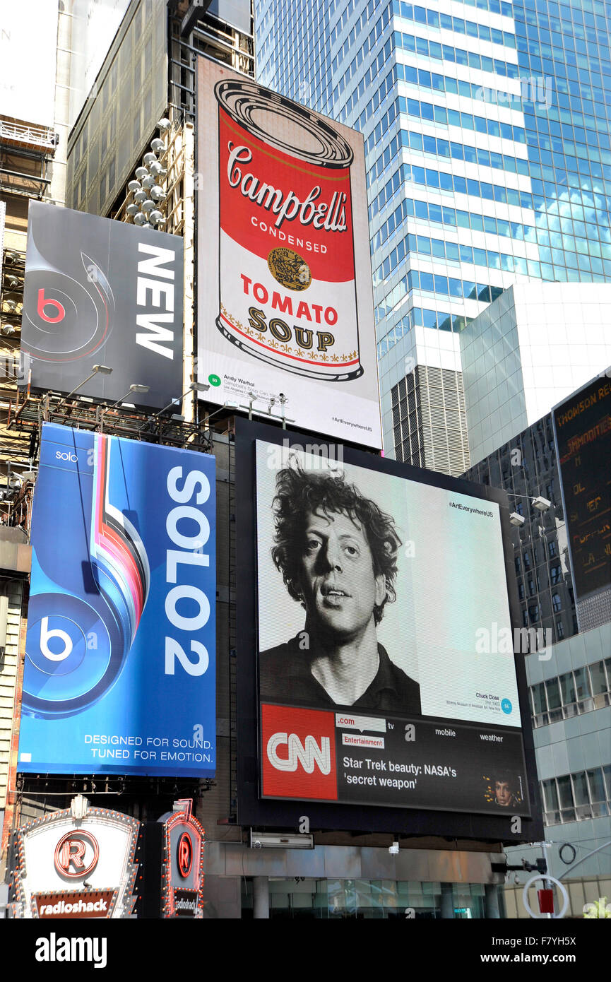 Fine Art images by artists Andy Warhol and Chuck Close appear on digital billboards in  New York's times Square - Stock Image