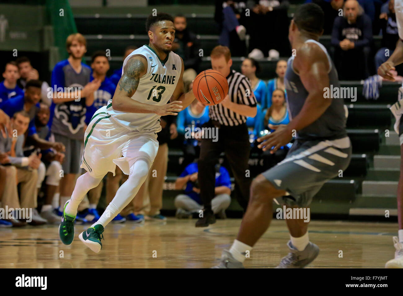 December 2, 2015: Tulane Green Wave guard Malik Morgan (13) advances the ball down court during the game between - Stock Image