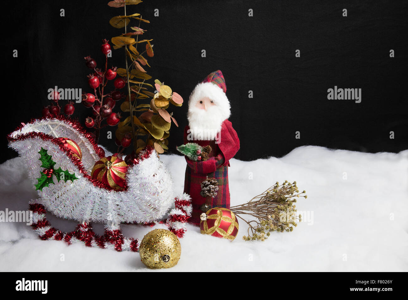Home decor Santa and his sleigh on snow and tree decorations table ...