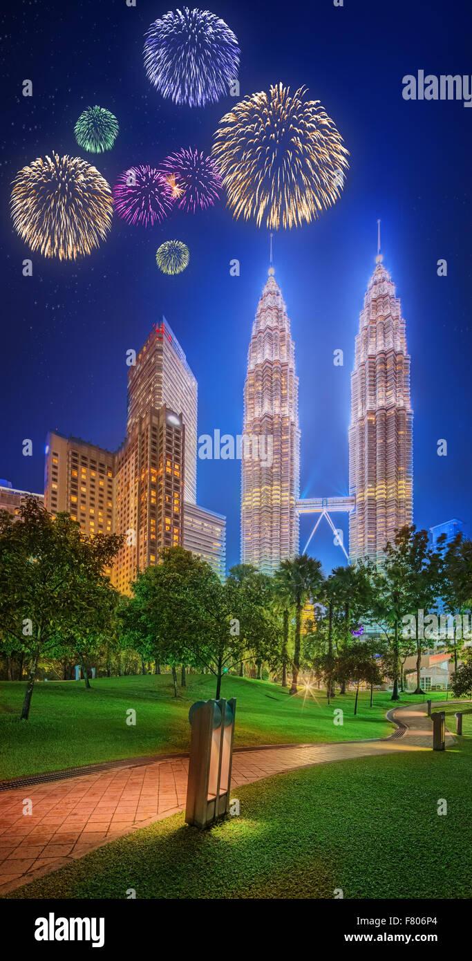 Beautiful fireworks above cityscape of Kuala Lumpur skyline at night, Malaysia - Stock Image