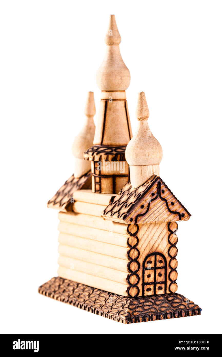 a small russian wooden house or church model called izba isolated over a white background - Stock Image