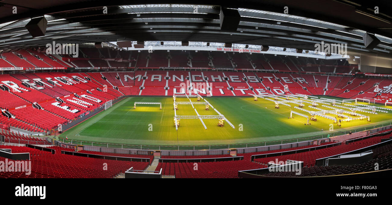 Manchester United pitch with solar lamps on grass turf in winter Stock Photo