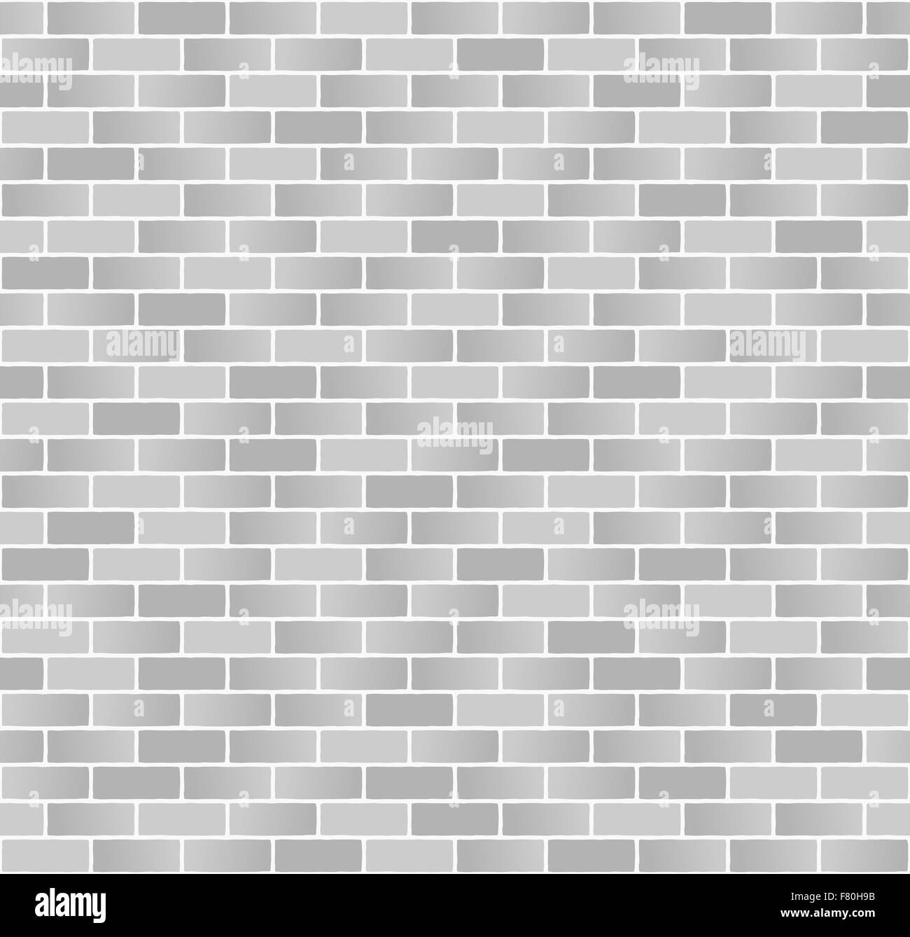 Seamless monochrome brick wall pattern of varied shades on white mortar background. - Stock Image