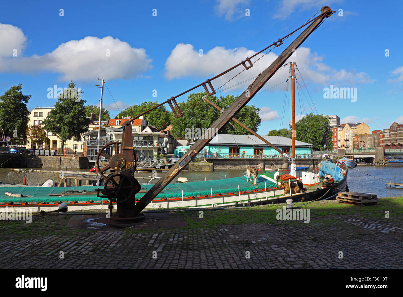 A very old wharf side crane lying idle and looking neglected - Stock Image