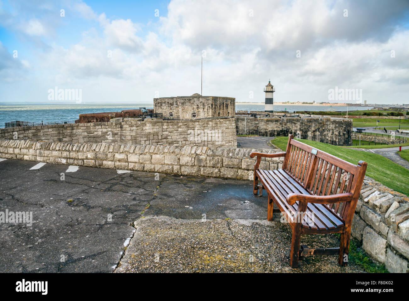 Southsea Castle and lighthouse seen from Southsea Commons, Portsmouth, England, UK - Stock Image