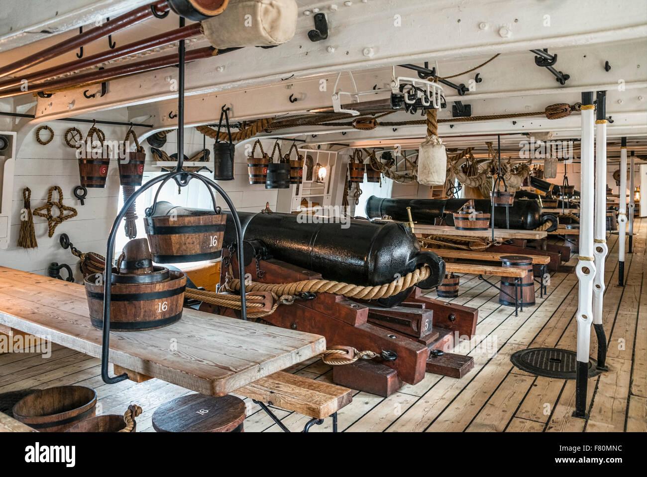 Lower gun deck of HMS Warrior at the Portsmouth Historic Dockyard, England, UK. - Stock Image