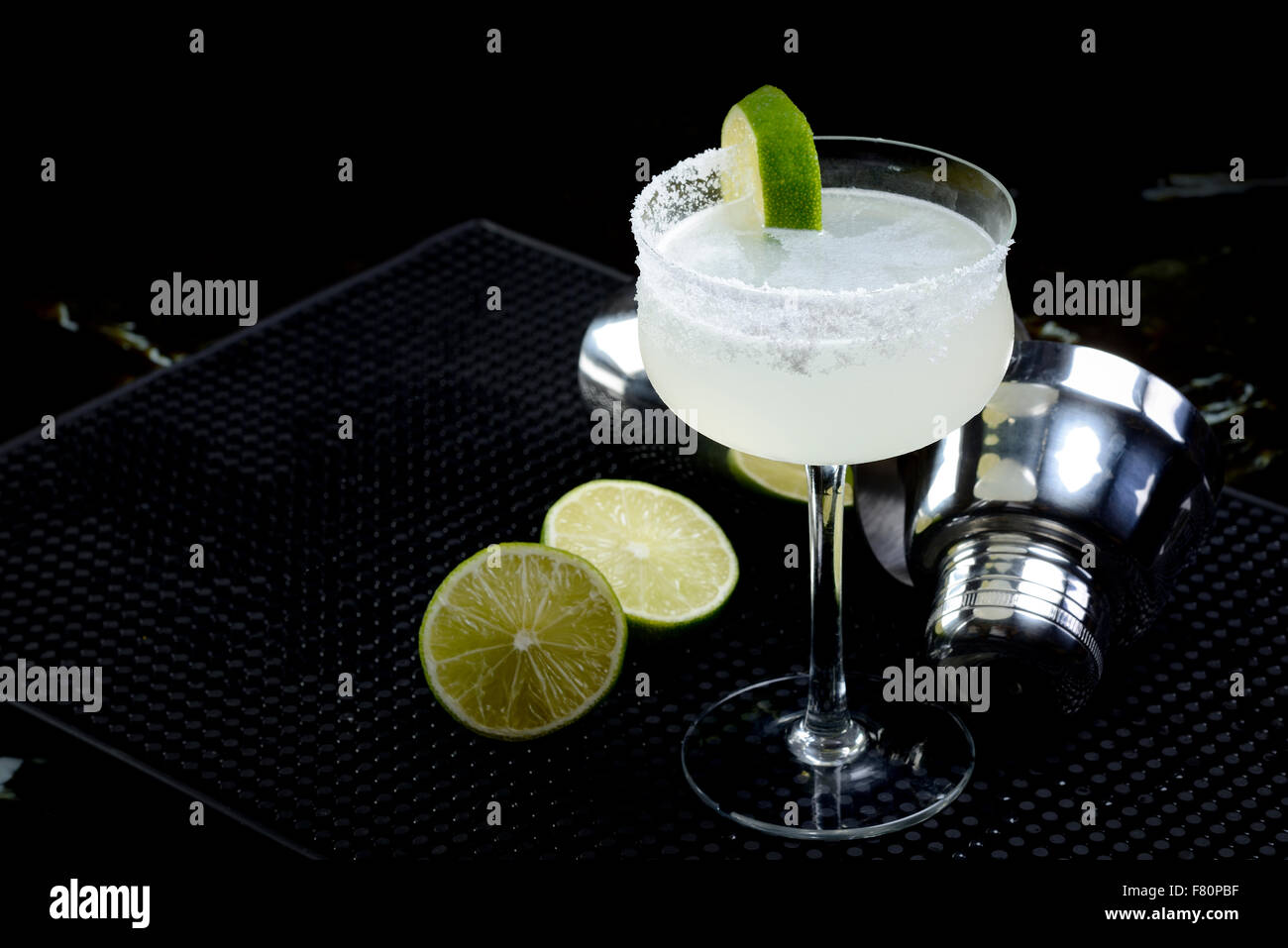 Margarita with shaker and lime - Stock Image