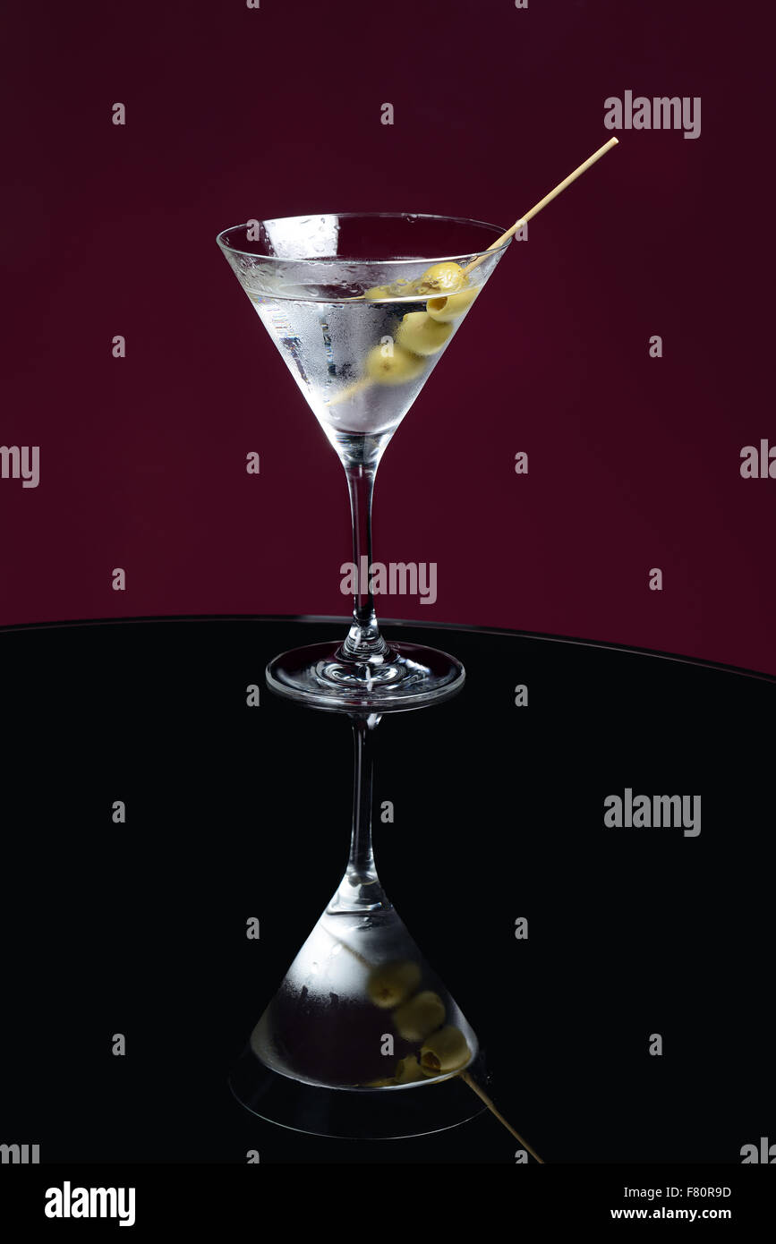 martini cocktail on the table with olives - Stock Image