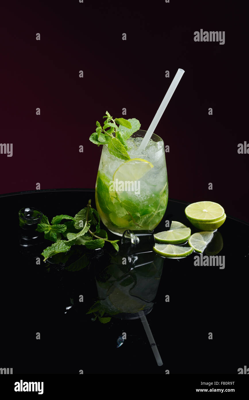 Mojito with lime ice and mint - Stock Image