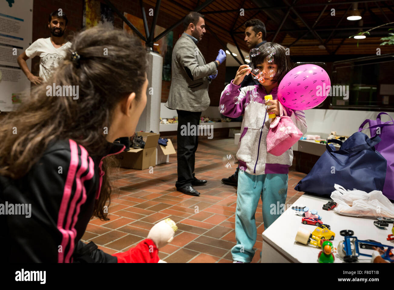 In the refugee arrival in Dortmund Keuning house the refugees of volunteers are supplied with food and clothing. - Stock Image